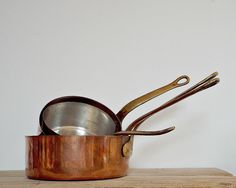 Gorgeous French vintage copper pans - set of 4 saucepans tin lined bronze handles by viadeinavigli on Etsy https://www.etsy.com/listing/209299738/gorgeous-french-vintage-copper-pans-set