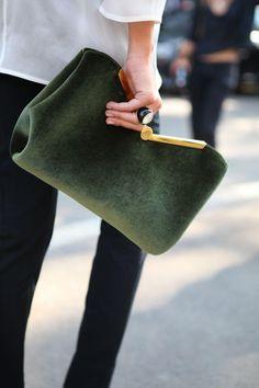 Green bag, black pants.