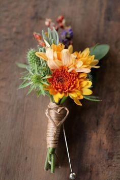 October wedding unique boutonniere. Thought this was sweet. Colors could change according to your palette.