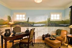 Designer: Witt Construction, Saratoga Springs, NY A custom wall mural that depicts a subtle landscape in this home study with traditional furniture. The landscape is a brilliant way to bring the outdoors indoors and create an engaging visual.