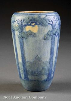 "A Newcomb College Art Pottery Vase, 1921, decorated by Anna Frances Simpson in the ""Tall Pine and Moon"" motif, matte glaze with blue, green and yellow underglaze, base marked with Newcomb cipher, decorator's mark, Joseph Meyer's potter's mark, reg. no. LN55, and shape no. 236, height 6 3/4 in"