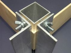 Corner Clamp - Homemade corner clamp fashioned from aluminum angle and a length of square aluminum tubing. Secured with wing nuts for ease of removal.