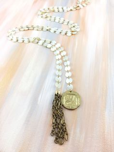"""Infinite Riches"" - 1940's mother of pearl lariat chain paired with an antique Greek coin from Athens and a vintage tassel"