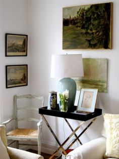 Artistic nook. art corner, living rooms, side tables, cozy corner, first apartment, white walls, tray, end tables, vintage art