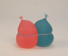 """rkitson:   Two Balloons 2010 7x7x4"""" Tinted Resin, Rubberband"""