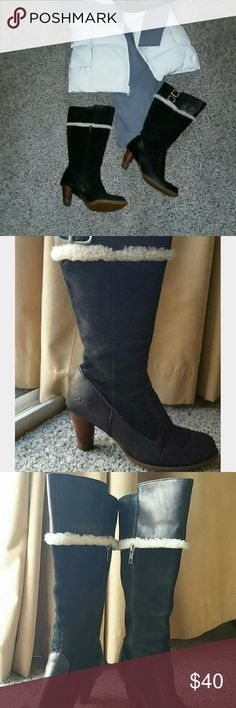 Ugg heeled boots Black leather and suede authentic Ugg boots.  Shearling trim and double buckles.  Some damage to the inside of the heels see pic 4.  Price reflects condition. UGG Shoes Heeled Boots