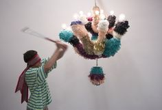 Misha Kahn: Paper Maché, lights, candy.  Way more fun than pulling off the tablecloth.  (One day I'll have a site that lets me write with Tildes! )