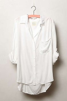 Oversized button down. Wear it with skinnies or shoots, and booties.