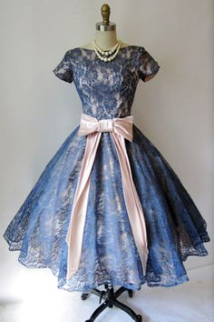 1950s cocktail dress  blush pink silk sash and under dress with blue lace overlay.  Fit and flare.