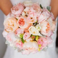 This full blossom bouquet is any brides dream! The soft pink colors are perfectly accented with touches of Spring green!