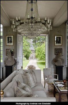 Charles Spada....love the huge chandelier in a worn setting