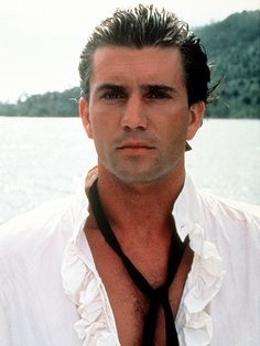 The Sexiest Photos Ever of Our 25 Sexiest Men Alive | 1985: MEL GIBSON  | We'd definitely opt for the sea life with a sailor like Gibson in The Bounty.