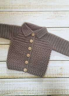 Crochet Baby Boy Sweater Pattern, Bentley Sweater - Crochet Dreamz This crochet baby boy sweater features a beautiful mix of 2 textured stitches and a sylish shawl collar. Boy Crochet Patterns, Crochet Baby Sweater Pattern, Crochet Baby Sweaters, Crochet Baby Jacket, Gilet Crochet, Baby Sweater Patterns, Baby Patterns, Knitting Sweaters, Crochet Designs