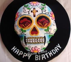 Dia de los Muertos cake design. Not a recipe per se, but a wonderfully decorated cake. The holiday's just around the corner!