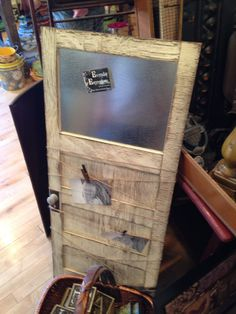 DIY small door. Magnetic message center with clothes pin picture or note display.
