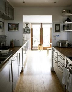 London kitchen with gray cabinets, ebony stained countertops, bamboo floor | Remodelista