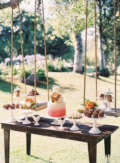 loving this dessert display with suspended sweets and milk glass