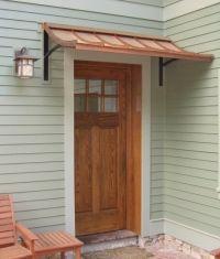 metal awning above garage doors Copper Awning, Metal Awning, Copper Roof, Porch Awning, Porch Roof, Front Door Overhang, Canvas Awnings, Window Awnings, Entrance Doors
