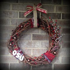 Ohio State grapevine wreath, made with yarn, OSU letters and berries from the Christmas section at Hobby Lobby + real buckeyes!  Rustic college team decoration