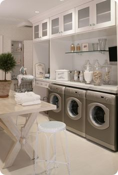 I love the laundry room inspiration with white cabinets and vintage looking teal knobs