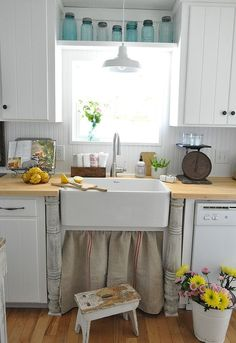 farmhouse kitchen remodel, home decor, kitchen design, Farm sink with vintage columns and a grain sack sink skirt