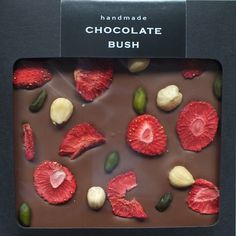 handmade milk chocolate bar with strawberries, hazelnuts and pistachios