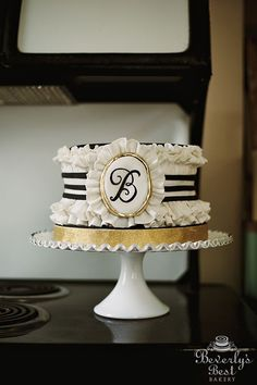 Fondant Ruffle Cake with Monogram Plaque by Beverly's Best Bakery