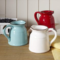 This pitcher is sized to make just enough of a statement. Beautiful for entertaining and durable for everyday use. Crafted of glazed ceramic with a rustic finish. Farmhouse Tabletop, Farmhouse Decor, Best Kitchen Designs, Drink Dispenser, Punch Bowls, Ceramic Pitcher, Traditional Furniture, Drinking Glass, Dinnerware Sets