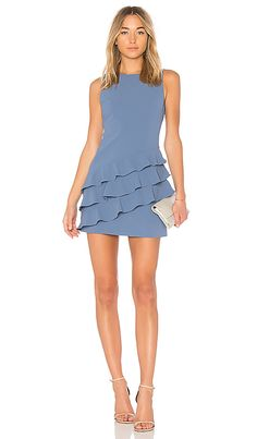 Shop for Alice + Olivia Clive Asymmetric Ruffle Dress in Denim Blue at REVOLVE. Free 2-3 day shipping and returns, 30 day price match guarantee.