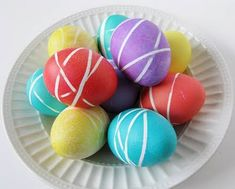 Rubber Band Easter Eggs. Just wrap rubber bands around eggs before dying them to get this unique look.
