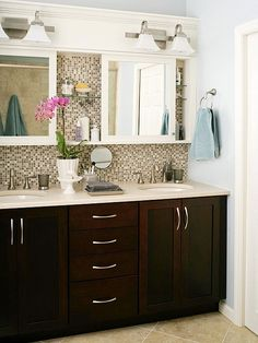 Double vanity bathroom... Absolutely love the backsplash and this has amazing storage in the sliding mirrors I love this!! If only I had the money to do this
