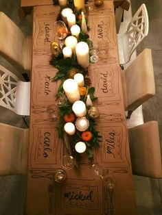 We love this idea! Personalized brown paper tablecloth with candles & greenery