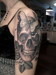 Skull and butterfly tattoo