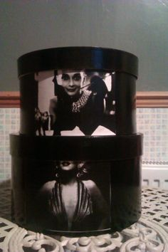 Revamped Hat Boxes.Spray painted black and decoupaged