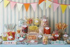 Love all the clear glass containers for the candies/toppings. A bunting of some sort is a must.