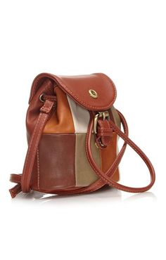 Ollie & Nic Mini tan duffel bag with mixed colour patches and drawstring fastening.