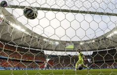 World Cup Final 2010 Rematch Spain vs Netherlands in Pictures - Robin van Persie of the Netherlands heads to score past Spain's Casillas during their 2014 World Cup Group B soccer match at the Fonte Nova arena in Salvador. MICHAEL DALDER/REUTERS