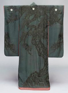"""Furisode, second half 19th century, Japan. """"Long-sleeved robe (furisode) with design of pine trees embroidered and couched in black silk on a black silk crepe ground, resist dyed; lined with red crêpe with design of bamboo embroidered in red silk; three white floral crests along the upper back and sleeves; padded hem. Silk plain-weave crepe ground embroidered and couched with silk; resist-dyed"""""""
