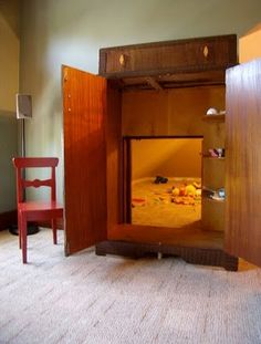 a wadrobe is repurposed as a door to a playroom.  this would have thrilled me as a kid- The Chronicles of Narnia were my favorite books.