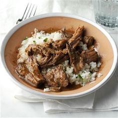 Slow Cooker Barbacoa Recipe- Recipes  My husband adores this roast simmered in lime juice, chipotle and cumin. I serve it over rice flavored with cilantro and more zippy lime. —Aundrea McCormick, Charles Town, WV