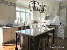 white kitchen wood island