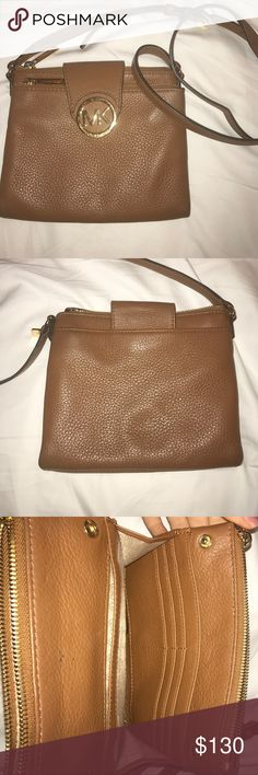 Michael Kors cross body bag Tan Michael Kors cross body bag, gold hardware, barely used. Two pockets with zippers and card slots. Michael Kors Bags Crossbody Bags