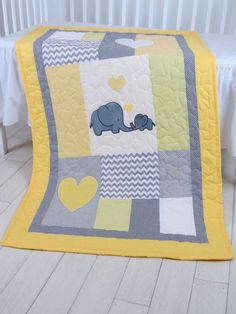 Image result for baby quilt with mom and baby elephant