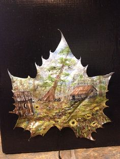 Painted leaf, framed leaf art, oil painting, landscape, cypress trees, cabin, outhouse.