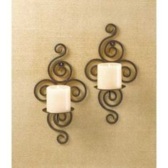 "32402 Scrollwork Candle Sconces  Description  Wrought-iron wall sconces feature a hypnotic ""twirl"" design."