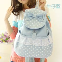 Canvas backpack with drawstring top, buckle close, cotton bow and lace trim.  Length: 30cm Width: 16cm Height: 36cm