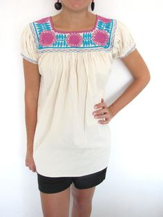A beautiful embroidered light weight blouse from the small village of Aguacatenango. Completely handmade and handstitched, all the way down to the bottom hem. 100% Cotton Short-sleeved Fits size Small Handmade in Chiapas, Mexico $50 chiapasbazaar.com