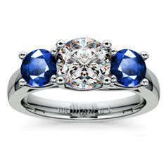Trellis Three Sapphire Gemstone Engagement Ring in Platinum Two perfectly matched round cut sapphire gemstones are prong set in this platinum gemstone engagement ring setting, accenting your choice of center diamond. Proudly made in the USA.