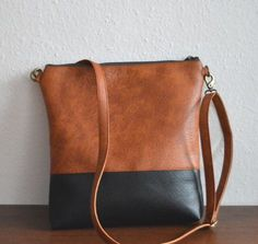 two tone cross body vegan bag. Color block black and brown cross body. Stitch Fix 2016 Perfect bag for fall. Big enough to fit kids things or iPad and other stuff. Thanks Stitch Fix. I love this