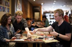 https://www.thestar.com/content/dam/thestar/news/gta/2016/01/14/burgeoning-board-game-caf-culture-makes-toronto-king-of-analogue-play/a-game-cafe13.jpg